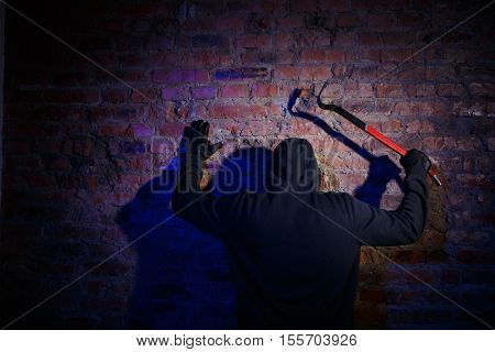 Gunman surrenders standing against wall