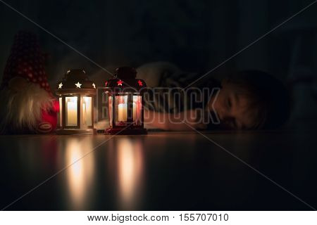 Beautiful Little Boy, Lying Down On The Floor, Looking At Candles