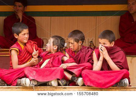 Lamayuru India - June 17 2012: Restless boys monks as spectators at the Cham Dance Festival of Tibetan Buddhism in Lamayuru monastery Ladakh India.