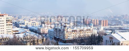 Winter panorama of the Penza city with residential areas and highway in a calm cold sunny day a top view in Penza Russia