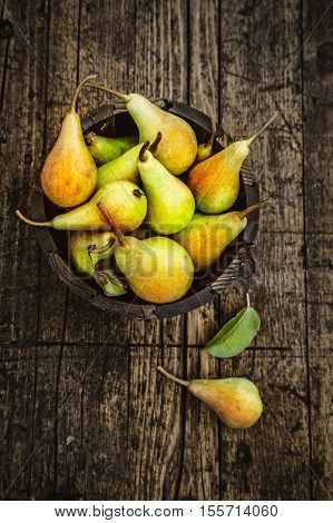 Fruit background. Fresh organic pears on old wood. Pear autumn harvest