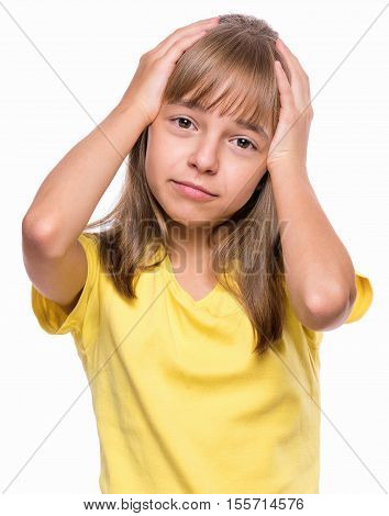 Stress and headache - little girl having migraine pain. Attractive child suffering from a headache. Unhappy caucasian young female touching her head, isolated on white background.