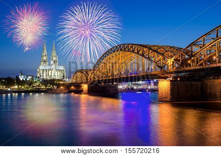 Cologne Cathedral and Hohenzollern Bridge with Fireworks on New Year day Cologne Germany.