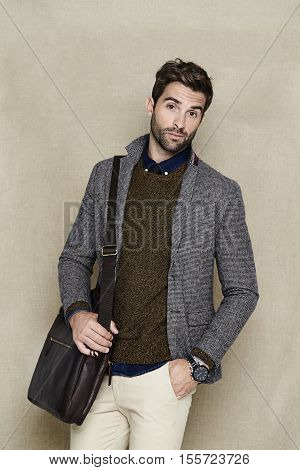 Confident man in blazer looking at camera