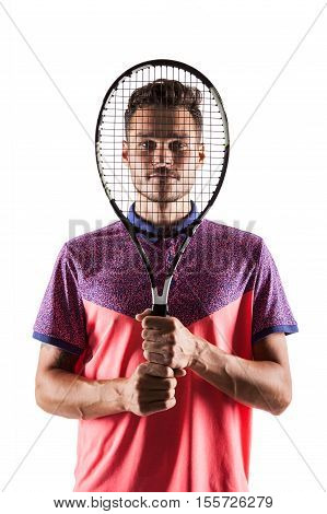 Handsome young tennis player posing with tennis racket in hand
