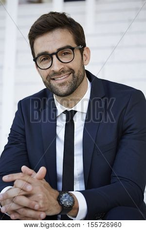 succesful young Smiling businessman with spectacles portrait