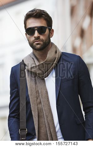 Shades guy with scarf and blazer in city