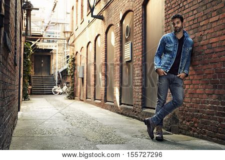 Man standing in street wearing denim portrait