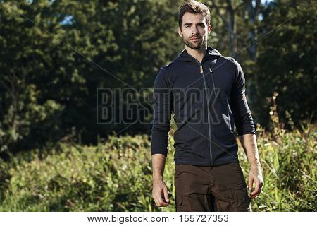 Portrait of handsome guy in park outdoors