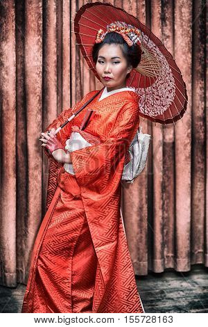 Attractive Asian Woman Wearing Japanese Kimono Holding Traditional Fan