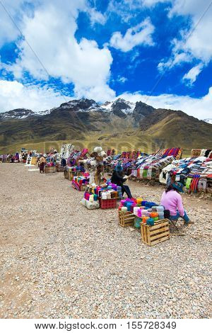PERU - SEPTEMBER 6, 2015: Unidentified women selling the traditional local textile items on the La Raya Pass near Sicuani, Peru