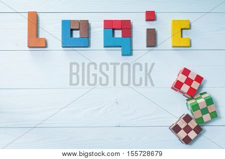 Logic background. The concept of logical thinking. The word of logic of multi colored wooden blocks on a wooden background