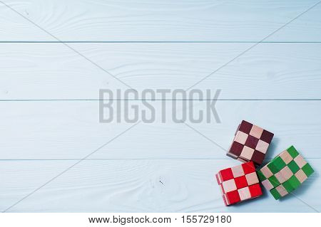 Logic background. The concept of logical thinking. Multi-colored wooden blocks on a blue wooden background.