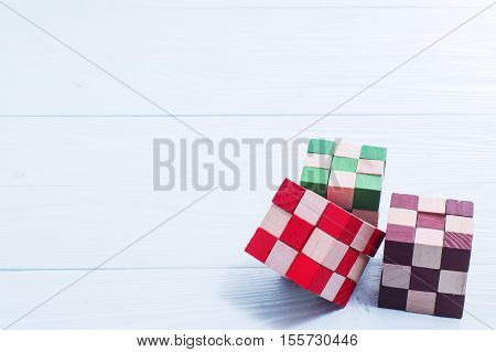 Colorful wooden blocks on a blue wooden background. Logic background. Logical thinking. Wooden colorful cubes puzzle.