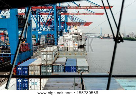 Hamburg, Germany - May 10, 2011: View through the windscreen of a large container ship at the Container Terminal Altenwerder in Hamburg, Germany while being loaded with containers before leaving for its next trip.