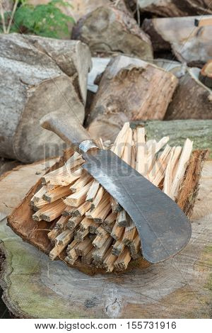 Billhook Knife On A Pile Of Firewood