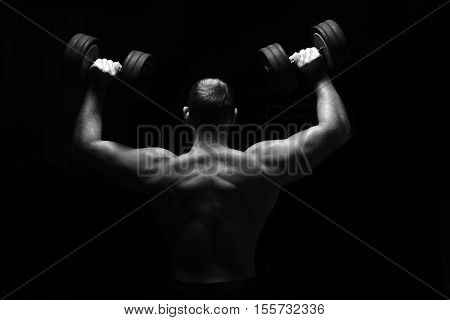 Man Makes Exercises With Barbell.