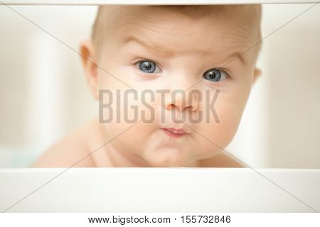 Cute Baby Making A Funny Wondering Face With His Eyebrows
