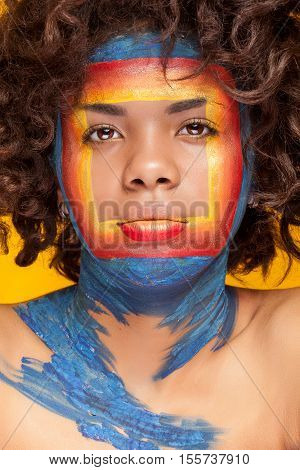 Afro American Girl With A Square Beauty Make Up On Her Face