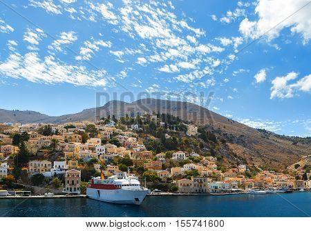 Aerial panoramic view of the pictorial old port of Symi island Greece