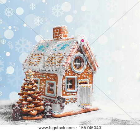 Assorted Christmas gingerbread cookies. Christmas gingerbread village house tree. Christmas New Year's background with snowflakes. Christmas card with gingerbread house Christmas tree reindeer Santa Claus