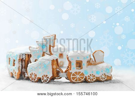 ngerbread Cookies in the form of train. Christmas cookies train covered with icing. Christmas Holidays sweets Gingerbread Cookies train. New Year card with snow Christmas gingerbread cookies train