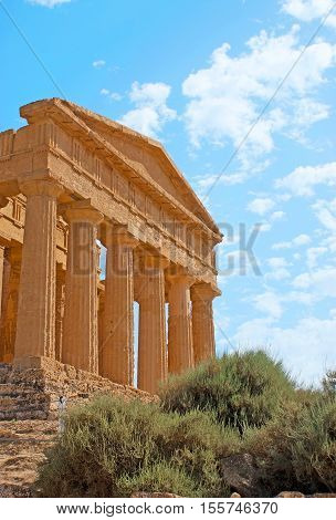 The facade of Concordia Temple with huge Doric colonade and preserved friezes Agrigento Sicily Italy.