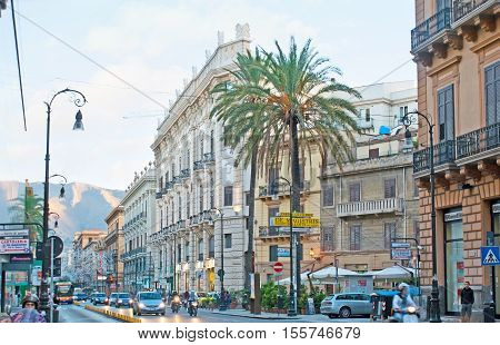 PALERMO ITALY - OCTOBER 2 2012: The Roma Street is one of the most popular shopping areas always full of people and cars on October 2 in Palermo.
