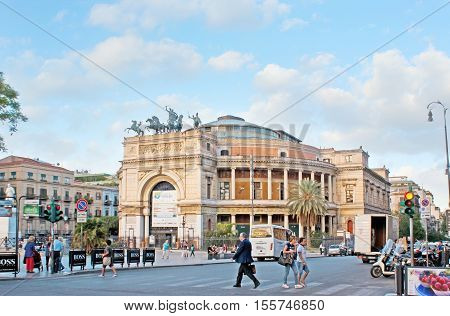 PALERMO ITALY - OCTOBER 2 2012: The facade of impressive Politeama Theater located in Square of Ruggero Settimo and decorated with the Triumphal Arch and bronze quadriga on October 2 in Palermo.