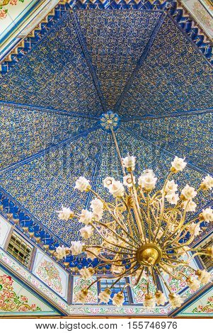 KAIROUAN TUNISIA - AUGUST 30 2015: The dome in chamber of Mansion of Governor decorated with golden floral pattern on the blue background on August 30 in Kairouan.