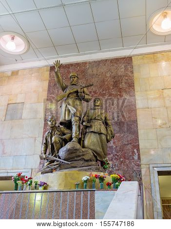 MOSCOW RUSSIA - MAY 10 2015: The hall of Partizanskaya Metro station decorated with the monument to Soviet Partisans who resisted the Nazis during WWII on May 10 in Moscow.