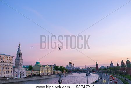 MOSCOW RUSSIA - MAY 10 2015: The scenic twilight over the Moskva River with the view on the Towers of Kremlin St Sophia Church and Cathedral of Christ the Savior on background on May 10 in Moscow.