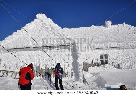 Ice covered house in the winter mountains