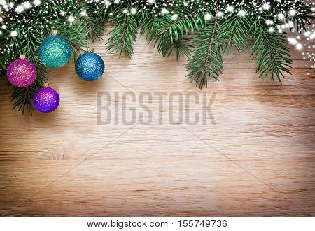Christmas background fir tree brunches and decorations at white wooden table. Top view copy space