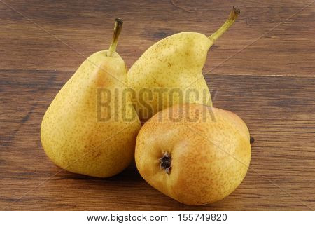 close up of pears on wooden table