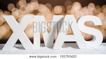 XMAS in white letter with blurred light background