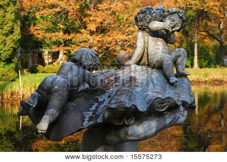 Playing children. A sculpture in park of the Chinese palace in Oranienbaum. Leningrad region. poster