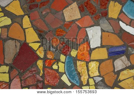 Colored mosaic on the gray clay surface