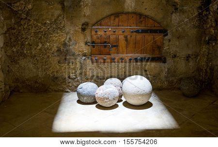 Crete, Greece - June 14, 2006: Stone cannon balls inside the Venetian fortress called Rocca al Mare