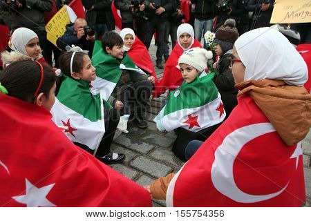 ISTANBUL,TURKEY-JANUARY 16. Syrians, living in Turkey, memorized for tourists who died the Sultanahmet suicide attack the site of Sultanahmet attack on January 16, 2016 in Istanbul,Turkey.