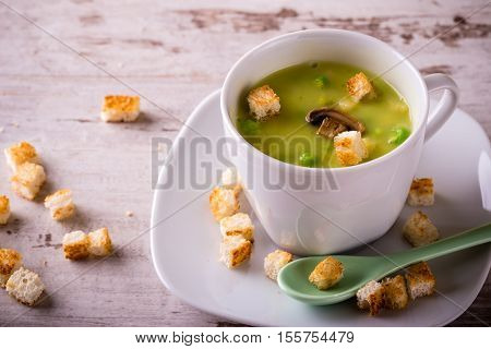 Split Pea Soup In White Cup On White Board