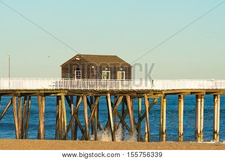 A fishing station built on a boardwalk jutting out over the ocean
