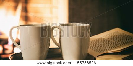 Cups Of Coffee Near A Fireplace