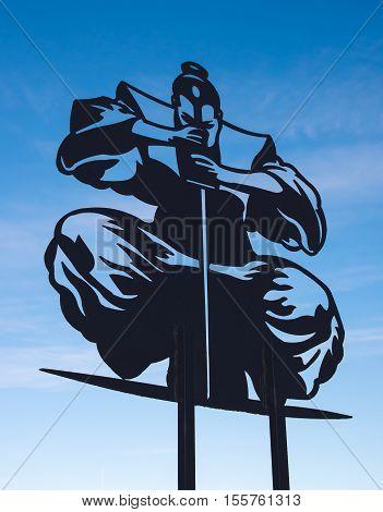 Samurai Silhouette on a background of blue sky
