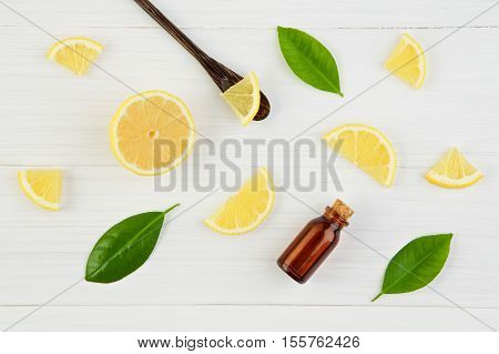 Fresh Lemons And Lemons Leaves With Essential Oil On Rustic Wooden Background. Fresh Lemons And Lemo