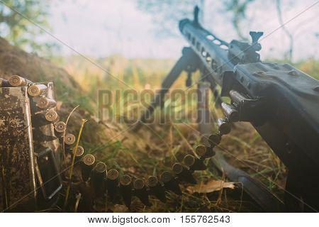 German military ammunition - machine gun of World War II on ground in trench.