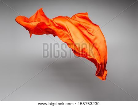 orange flying fabric - art object, design element