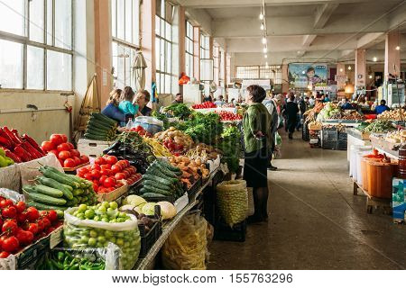 Batumi, Georgia - May 28, 2016: The Scene At Covered Market Bazar With Sellers Dealers And Buyers Among Abundant Counters With Agricultural Output.