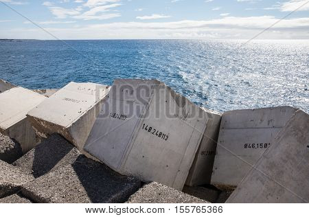 Concrete blocks numbered in the jetty of Los Cristiano (Tenerife - Spain)