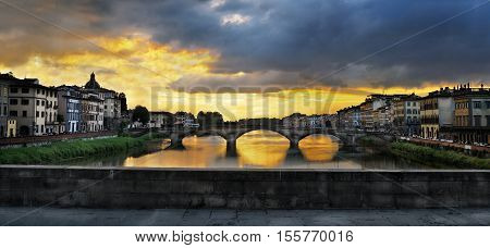 FLORENCE ITALY - JUNE 3- 2016: Ponte Santa Trinita (Holy Trinity Bridge) over River Arno View of after sunset gone at Ponte Santa Trinita- Florence Tuscany Italy.